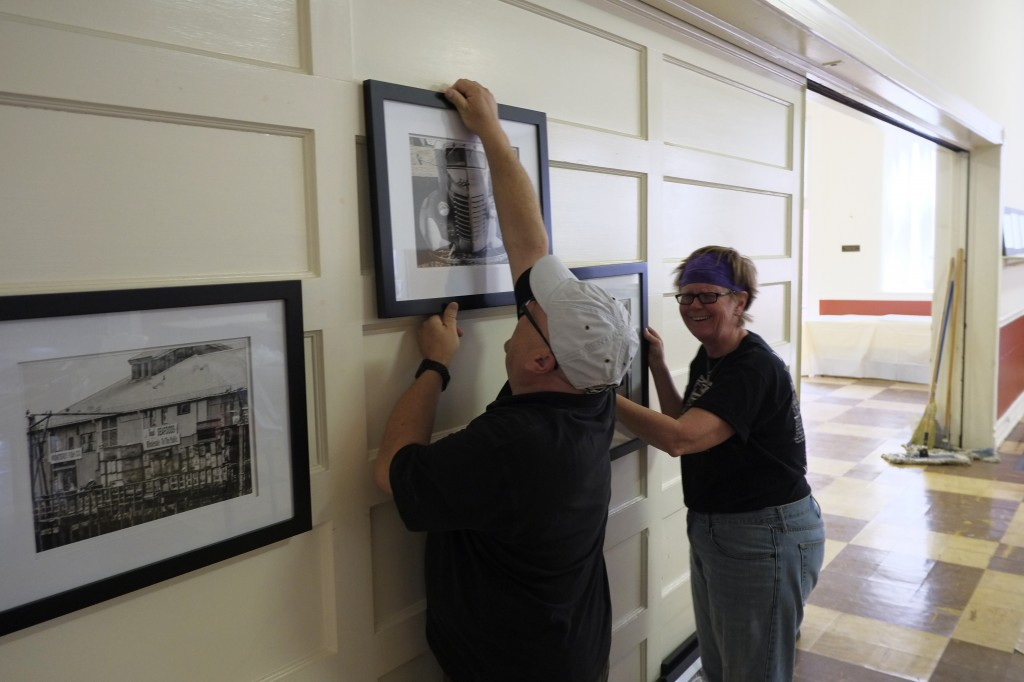 Art Club president, Tim Waterfill and member, Deb Conrad, start the process of hanging artwork for the show.