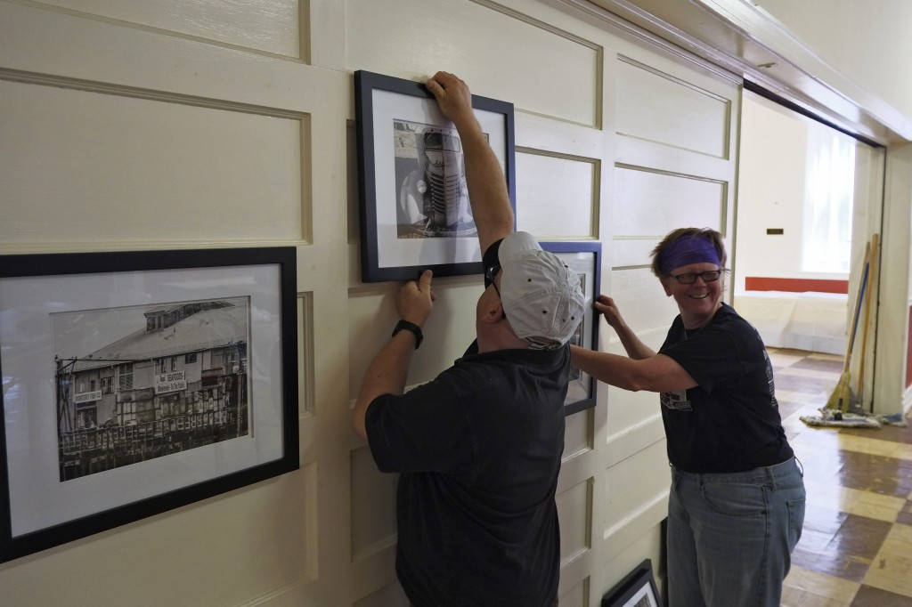 Art Club president, Tim Waterfill and member, Deb Conrad, have fun hanging artwork for the show.