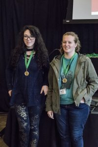 Katie Wheeler and Miriah Stewart receiving their Gold Award and Ivy Tech's IT Challenge.